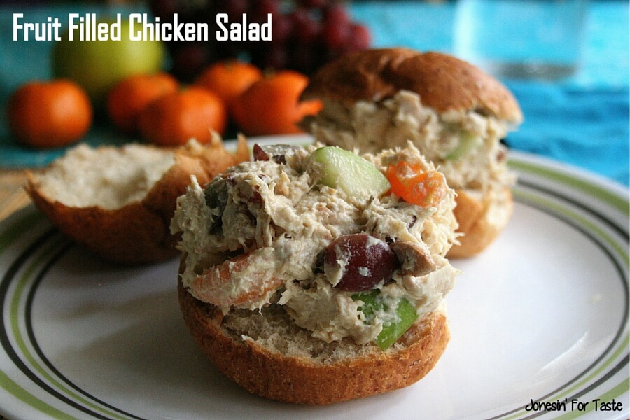 chicken salad with mandarin oranges, grapes, and apples on a roll