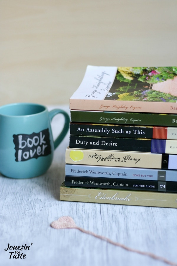 A stack of books for the Jane Austen lover beside a blue mug