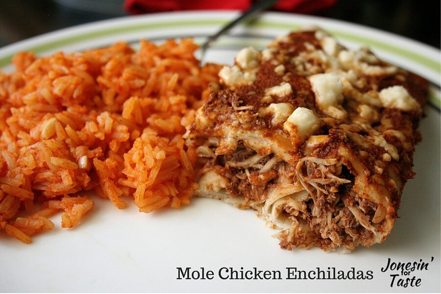 Mole chicken enchiladas are stuffed with deliciously spicy chicken slow cooked in a homemade mole sauce.