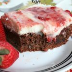 Brownie topped with cream cheese frosting and strawberry jam