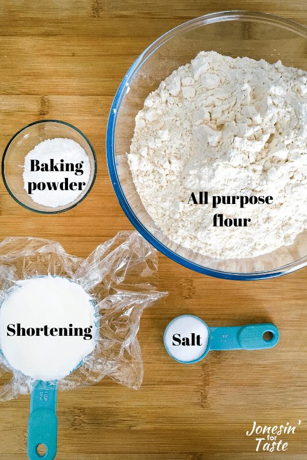 flour, salt, baking powder, and shortening on a wooden cutting board