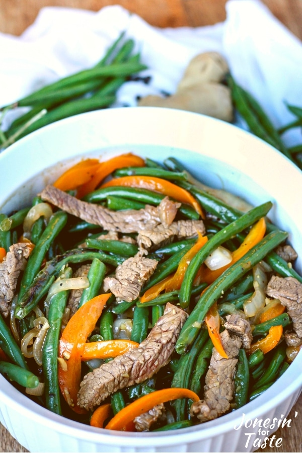 A serving dish with Cantonese Style Black Pepper Beef and green beans
