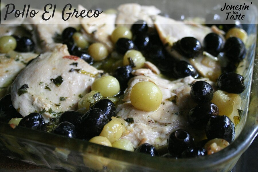 Chicken with olives and grapes in a casserole pan