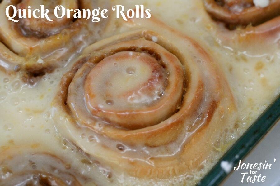 A close up shot of quick no yeast orange rolls with orange glaze.