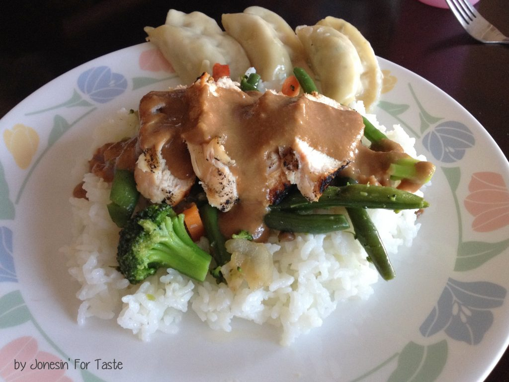 Grilled Chicken, stir fry veggies, and rice topped with a Thai Peanut Sauce.