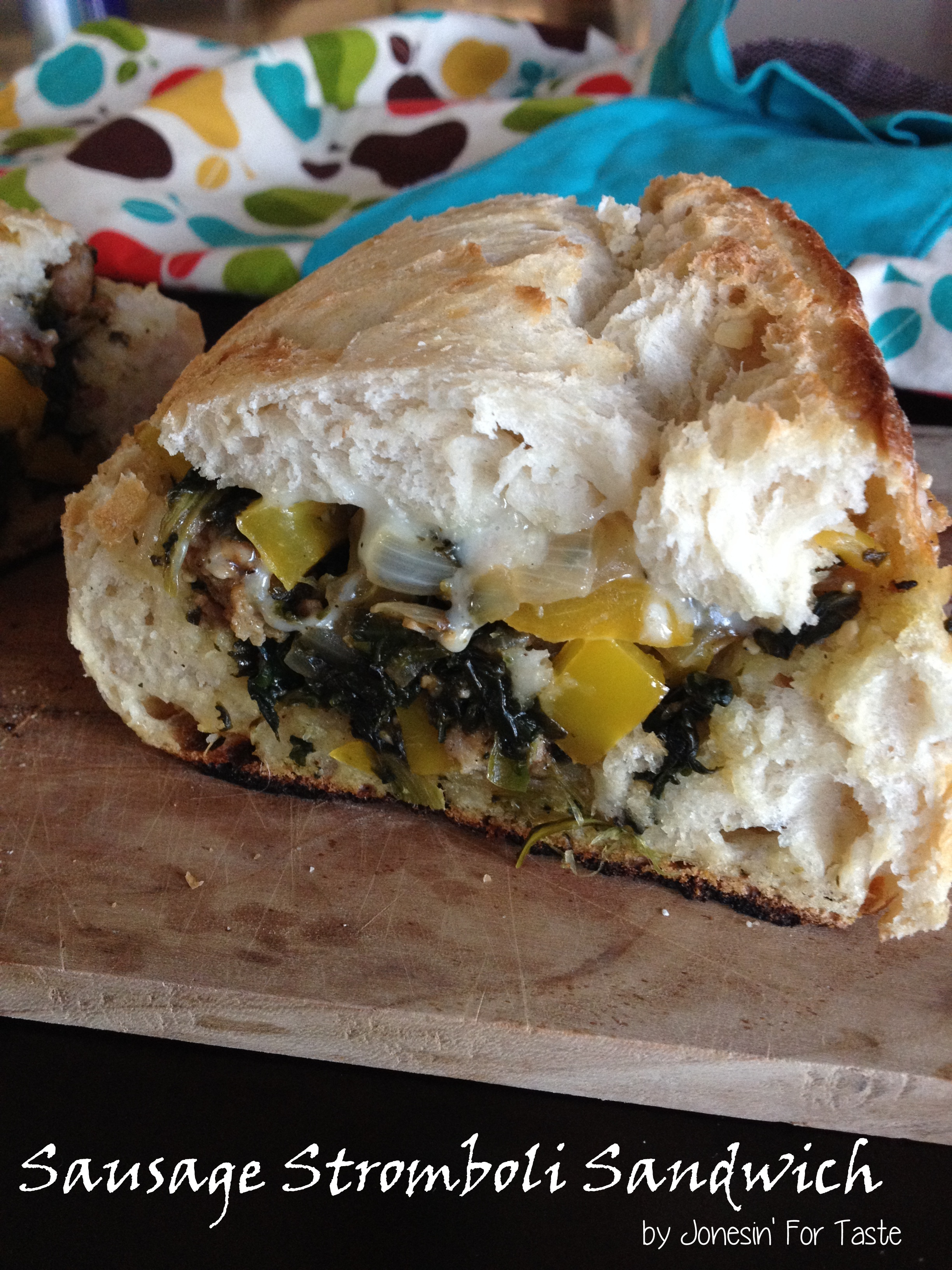 Sausage, bell peppers, spinach, onion, and provolone cheese are baked together for a delicious hot sandwich.