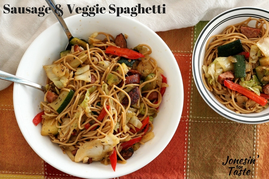 Sausage and Veggie Spaghetti in a large white bowl next to small bowl filled with more pasta