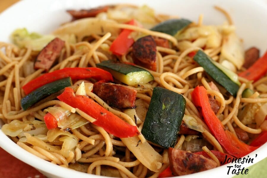 A close up of the Sausage and Veggie Spaghetti with strips of red pepper and zucchini on top of the pasta
