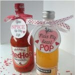 Two bottles, one hot sauce and one soda with Valentine's gift tags