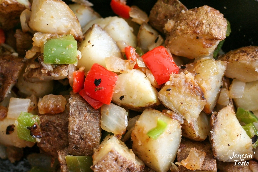 Cooked potatoes, chopped bell pepper and onions