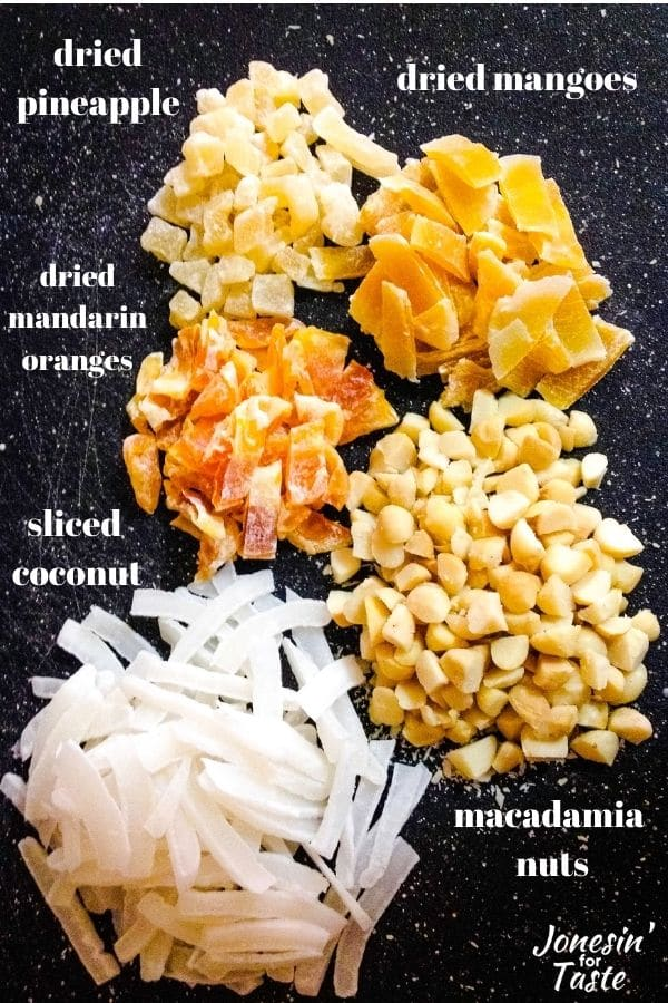 Tropical granola filled with coconut, macadamia nuts, pineapple, mango, and mandarin oranges.
