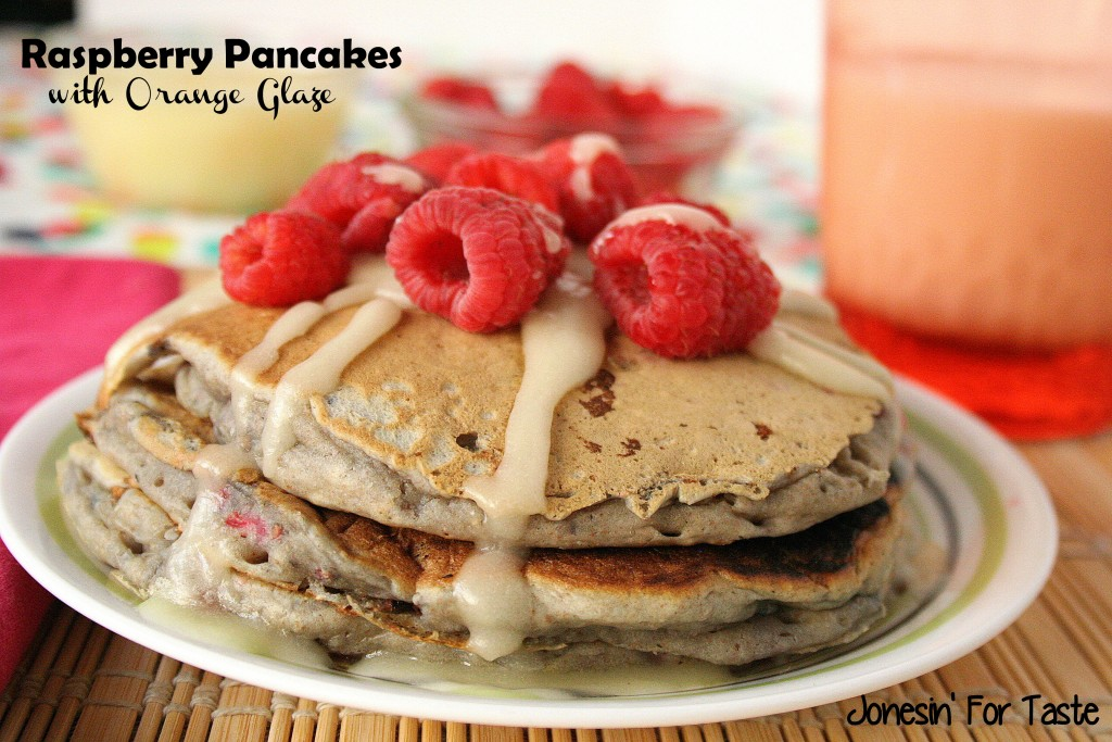 Raspberry Pancakes with Orange Glaze- fresh or frozen raspberries and oranges pair perfectly for these amazing pancakes.
