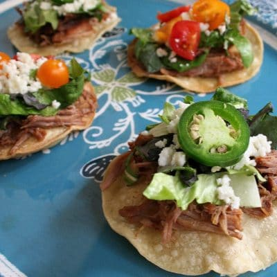 #ad Crispy corn tortillas is topped with slow cooked sweet pork, lettuce, queso fresco, chopped tomatoes, and jalapenos. It's a perfect appetizer for the big game day. #ScoreOnFlavor