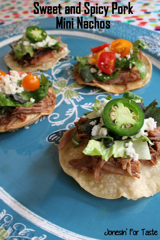 Crispy corn tortillas is topped with slow cooked sweet pork, lettuce, queso fresco, chopped tomatoes, and jalapenos. It's a perfect appetizer for the big game day.