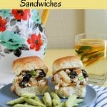 Two tropical chicken salad sandwiches on a plate with snap pea crisps.