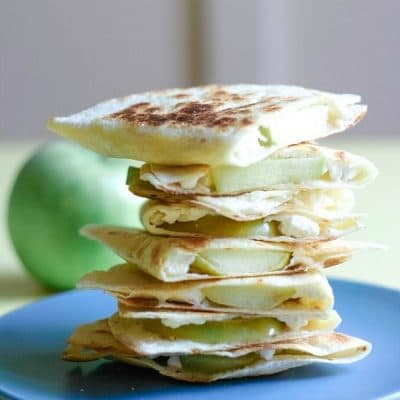 A tall stack of Apple Feta Quesadillas on a blue plate