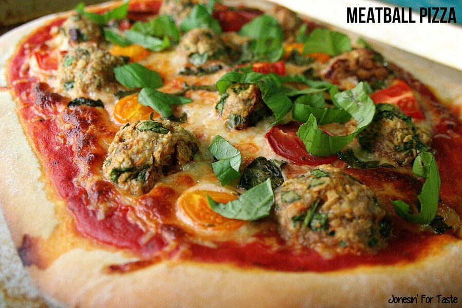A meatball pizza on a cookie sheet