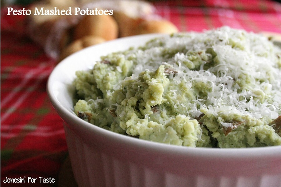 Mashed potatoes topped with parmesan cheese in a casserole dish