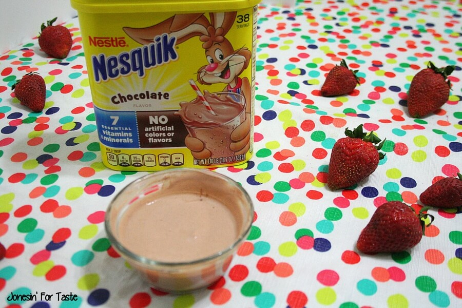 Keep your kids fueled for imagination with a yummy fruit dip. Only 2 ingredients are needed to make this simple Nesquik chocolate yogurt fruit dip that is perfect spread on pancakes too! #StirImagination