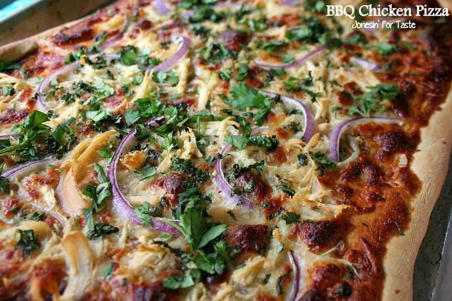 BBQ Chicken pizza topped with red onion and cilantro.