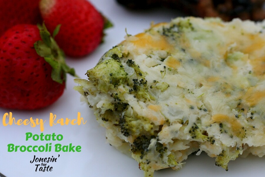 A scoop of Cheesy Ranch Potato Broccoli Bake stuffed with lots of broccoli and topped with cheese
