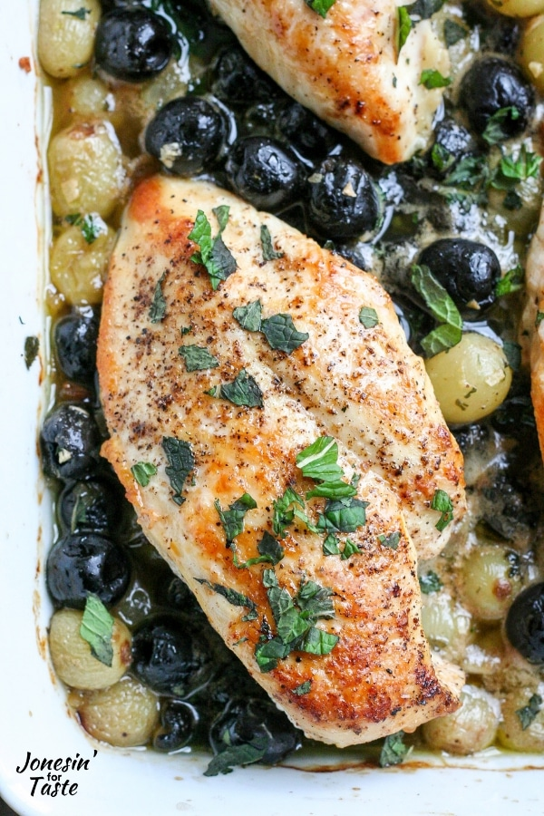 Chicken with grapes and olives in a sauce