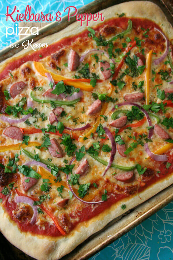 A simple and tasty Kielbasa and Pepper Pizza recipe that can be prepared in less than 30 minutes. The perfect meal for a busy family.