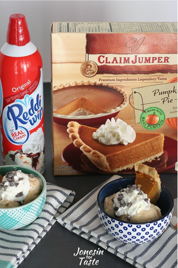A box of pumpkin pie and a bottle of Reddi-Wip behind two bowls of Pumpkin Pie Ice Cream Sundaes