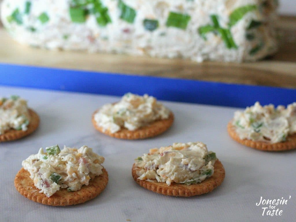 Ritz crackers with Bacon and Jalapeno Cheese Log spread on them.