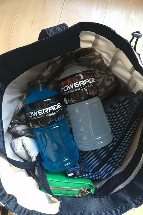 two bottles of powerade in a diaper bag