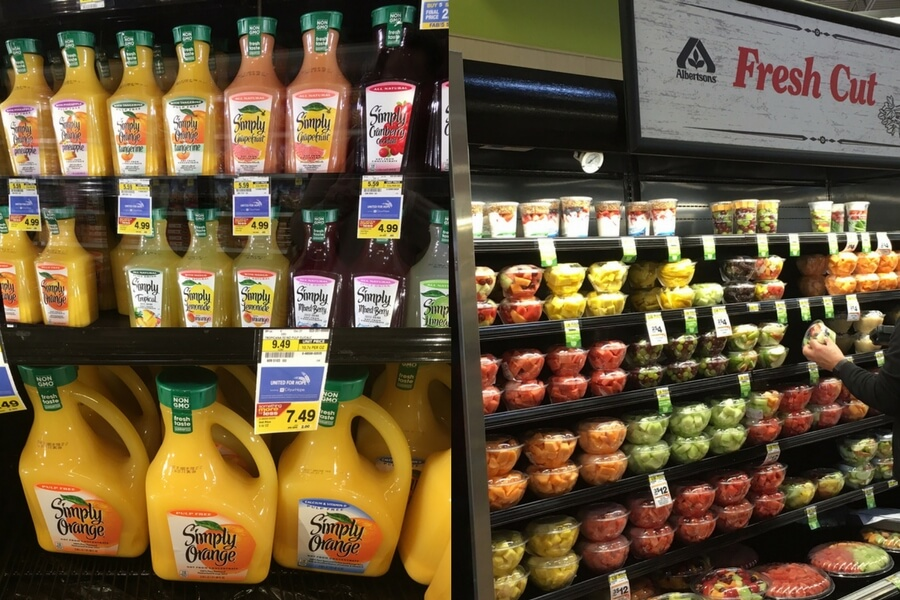 Orange juice and fresh fruit on the shelves in Albertsons