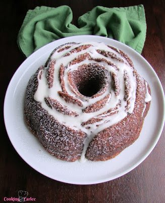 Easy Banana Bundt Cake in a beautiful rose shape topped with a simple glaze.
