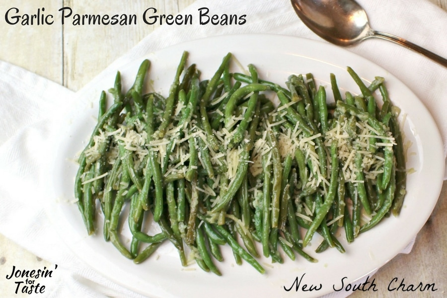 Parmesan Garlic Green Beans in a white dish on a table ready to be served