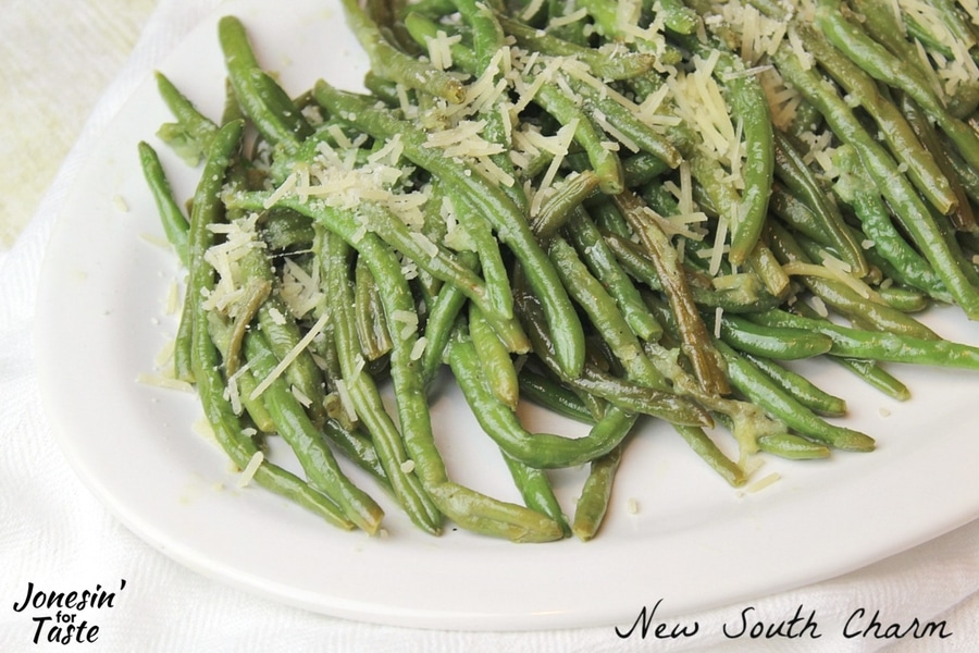 Close up view of Parmesan Garlic Green Beans sauteed and topped with parmesan.