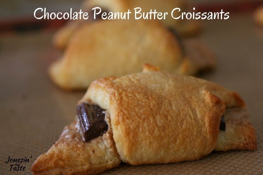 A cooked chocolate peanut butter croissant on a cookie sheet.