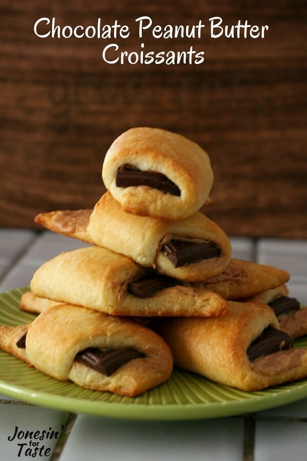 A pile of easy chocolate peanut butter croissants on a green plate.