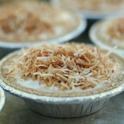 A close up view of a mini no bake coconut cheesecake