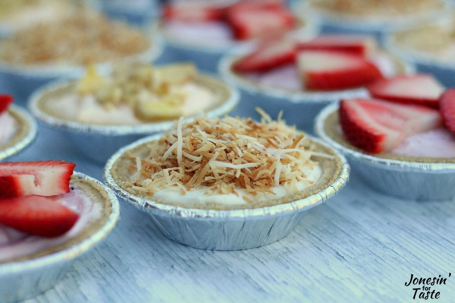 A mini no bake coconut cheesecake as part of a cheesecake flag.