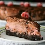 A slice of Cherry Chocolate Ice Cream Brownie Cake on a plate.