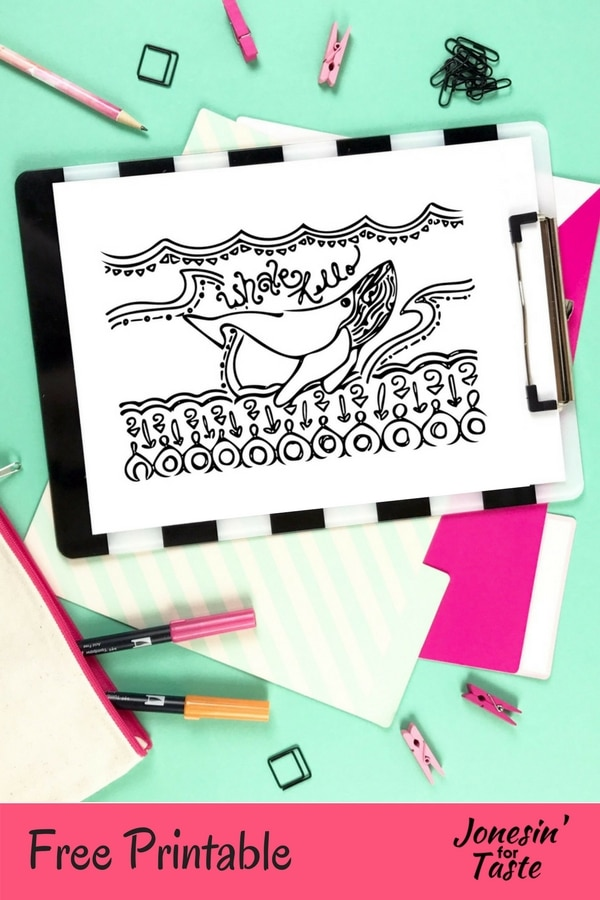 A desk with coloring supplies and a clipboard holding a whale coloring page