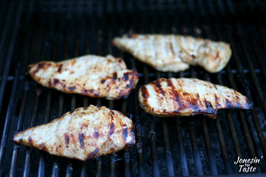 Chicken breasts being grilled