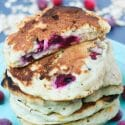 A stack of Oatmeal Cranberry Pancakes on a light blue plate.