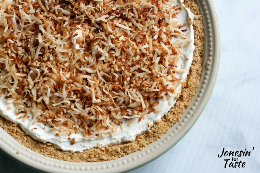 Looking down on a toasted shredded coconut topped no bake key lime pie