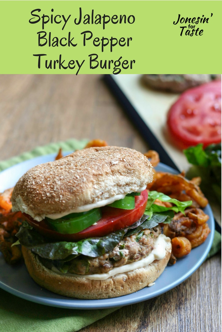 A spicy jalapeno black pepper turkey burger made with fresh jalapenos and lots of cracked black pepper and topped with sliced jalapenos and a easy spicy mayo spread. #CookoutWeek #jonesinfortaste #grilling #turkeyburgers #