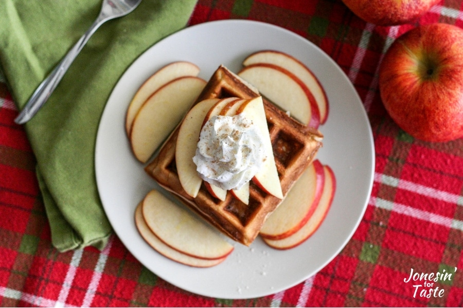 Chai spiced apple waffles topped with sliced apples and whipped cream
