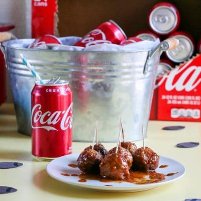 A plate of Coca-Cola BBQ Turkey Meatballs next to a can of Coke