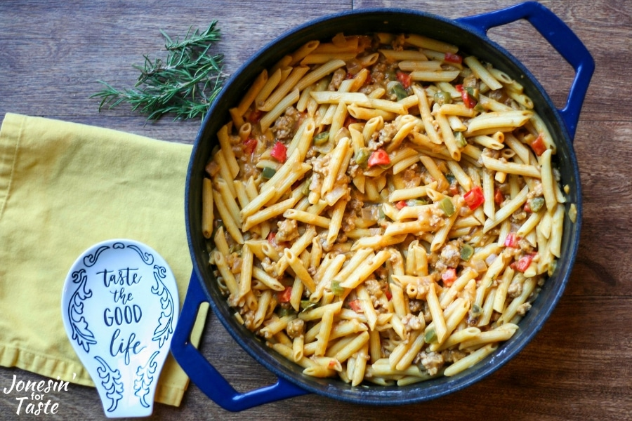A blue pot with pumpkin sausage penne pasta in it