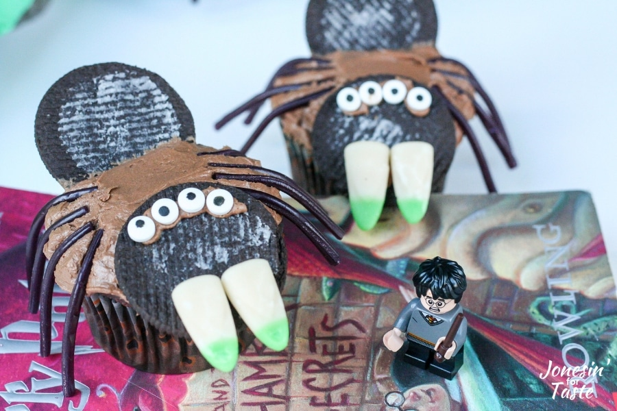 A Harry Potter Lego figurine next to Harry Potter spider cupcakes