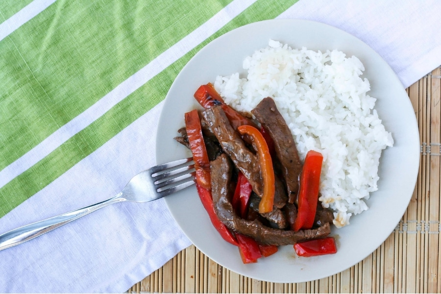 A plate of Asian pepper steak and rice