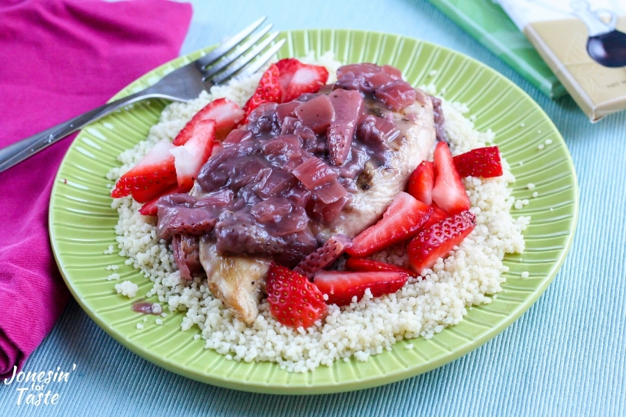 Strawberry Balsamic Chocolate sauce over chicken over couscous and sliced strawberries